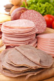 Wafer Thin Meat on a Cutting Board Stock Photos
