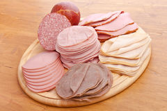 Wafer Thin Meat on a Cutting Board Stock Photography
