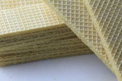 Wafer vanilla. Wafer biscuit on the white plate Stock Image