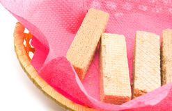 Wafers in a basket. Wafers in a wattled basket on a red napkin Royalty Free Stock Image