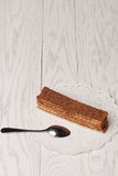 Wafers cake on table. Wafers cake with spoon on wooden table Stock Photography