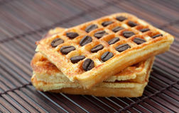 Wafers with coffee beans on a bamboo mat Royalty Free Stock Photography