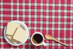 Wafers and coffee cup Stock Photos