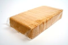 Wafers with a cream in polyethylene packing. On diagonal Royalty Free Stock Photo