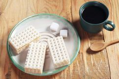 Wafers and coffee Stock Images