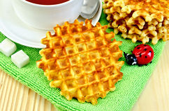 Waffles circle with tea on a napkin Stock Photo