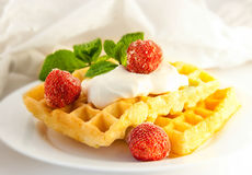 Wafers with a strawberry, a tasty dessert Royalty Free Stock Images