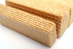Wafers with a vanilla cream macro. On diagonal Royalty Free Stock Photo