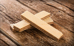 Wafers on wooden table. Royalty Free Stock Photography