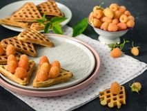 Wafers and yellow raspberries. stock images
