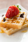 Waffel with strawberry, honey and chocolate Royalty Free Stock Photo