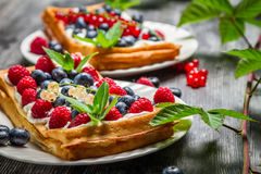 Waffels with cream and blueberry and raspberry Royalty Free Stock Photography
