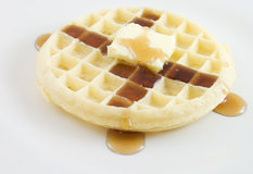 Waffle. On a plate with butter and syrup Stock Images