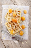 Waffle with apricots and almond splinters Royalty Free Stock Photos