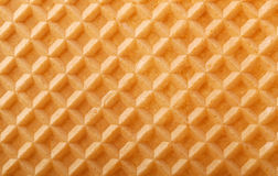 Waffle background. Structure of a baked golden waffle background Stock Photo