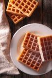 Waffle. Baked waffle on wood background stock photo