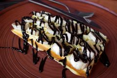 Waffle with banana and chocolate topping Stock Image