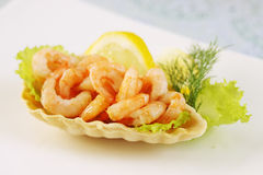 Waffle basket with shrimp. Crispy waffle basket with shrimp and lemon Royalty Free Stock Photo