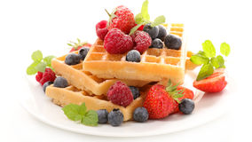Waffle with berries fruits. On white stock image