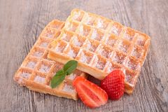 Waffle. And berry on wood Royalty Free Stock Image