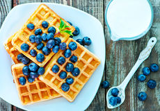 Waffle. With blueberry on the plate and on a table stock photography