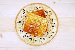 Waffle with Chocolate Chip and Banana. On the Table Wooden Royalty Free Stock Images