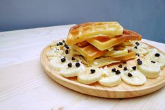 Waffle with Chocolate Chip and Banana. On the Table Wooden Stock Photography