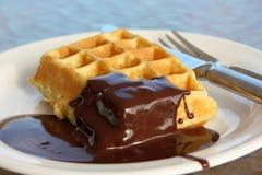 Waffle with chocolate cream. Belgian waffle with chocolate cream on the plate Royalty Free Stock Image