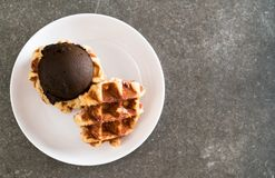 Waffle with chocolate ice cream. On the table Stock Photo