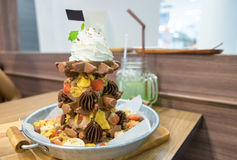 Waffle chocolate ice cream with various fruit and whip cream Stock Images