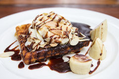 Waffle with chocolate sauce almonds closeup Stock Photography