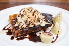 Waffle with chocolate sauce almonds closeup. Shooting day light Stock Photography