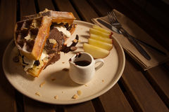 Waffle with chocolate. Sauce and chocolate icecream with brownie and wipcream and apple Stock Image