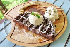 Waffle chocolate. Serve with banana and whipped cream Royalty Free Stock Photo