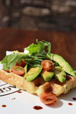 Waffle. Close-up Waffle with avocado, spring mix, tomato royalty free stock photos