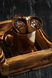 Waffle cone with whipped cream and chocolate on a wooden tray.selective focus Royalty Free Stock Photo