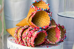 Waffle cones and сoloured сandies. Waffle cones and сoloured candies - stars, marbles, hearts Stock Photography