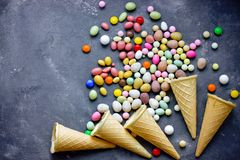 Waffle cones with candy sweets. Top view stock image