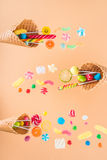 Waffle cones with different delicious jelly candies and lollipops Stock Image