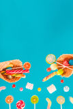 Waffle cones with different delicious jelly candies and lollipops Royalty Free Stock Images