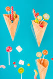 Waffle cones with different delicious jelly candies and lollipops Royalty Free Stock Photography