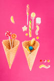 Waffle cones with different delicious jelly candies and lollipops Stock Photo
