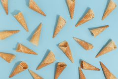Waffle cones for ice cream on a blue background. Top view royalty free stock image