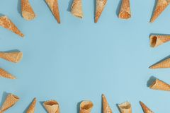 Waffle cones for ice cream on a blue background. Top view. Delicious ice-cream food milk yummy refreshment overhead flavor wafer tasty sweet calorie dessert royalty free stock images