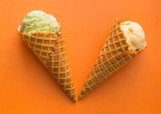 Waffle cones with pistachio and vanilla gelato ice cream . Stock Images