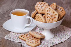 Waffle cookies in bowl. On the desk Stock Photos