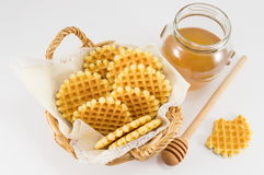 Waffle cookies in a wicker basket royalty free stock image
