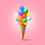 Waffle cornet with balloons. Isolated on pink Royalty Free Stock Image