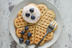 Waffle with cream and blueberries Stock Images