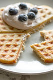 Waffle with cream and blueberries Royalty Free Stock Photo